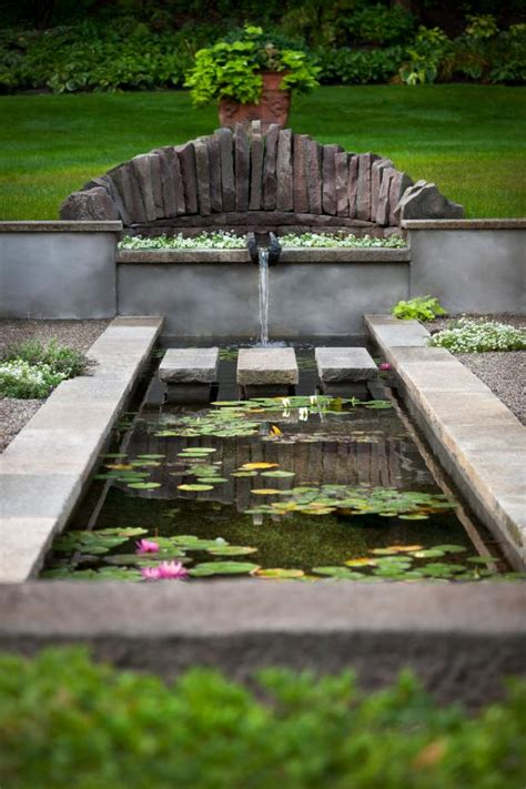 Koi Pond Surrounded by Antique Pavers   HGTV